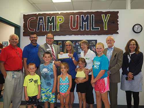 PBPA officers and members donate a check to the UMLY summer camp program