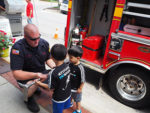 Paoli Fire Company showing kids equipment they use